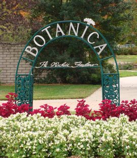 The blooms and archway entrance to botanica